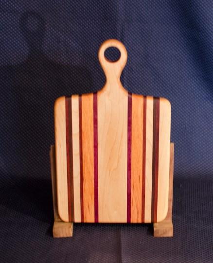 "Sous Chef 16 - 014. Black Walnut, Hard Maple, Purpleheart, Honey Locust & Canarywood. 9"" x 12"" work surface & 4"" handle."