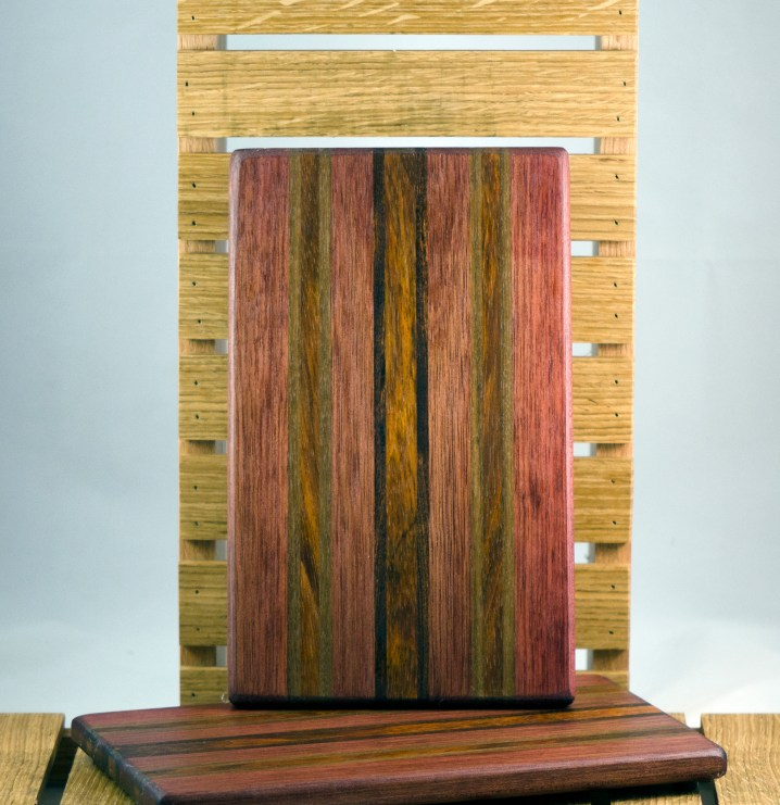 "Cheese Board 16 - 025. Bloodwood, Black Walnut, Jatoba & Caribbean Rosewood. 7"" x 11"" x 3/4""."