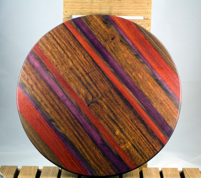 "Lazy Susan 16 - 021. Black Walnut, Padauk, Purpleheart & Caribbean Rosewood. 17"" diameter. Sold in its first showing."