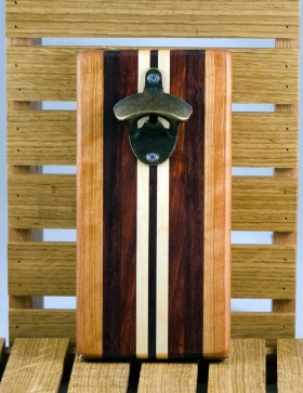 "Magic Bottle Opener 16 - 016. Wall mount. Cherry, Black Walnut, Bloodwood & Hard Maple. Approximately 5"" x 10"" x 3/4""."