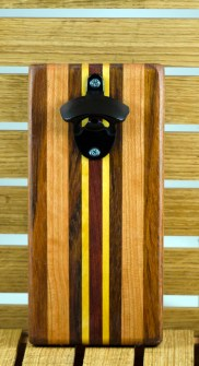 """Magic Bottle Opener 16 - 077. Jatoba, Cherry, Yellowheart & Bloodwood. Double magic, so it will mount to your attractive refrigerator. Approximately 5"""" x 11"""" x 3/4""""."""