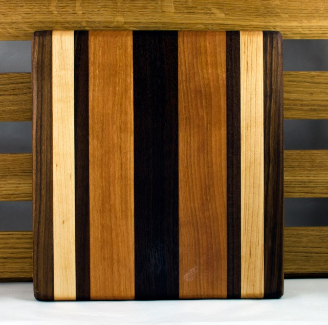 "Cheese Board 16 - 031. Black Walnut, Hard Maple & Cherry. 9"" x 12"" x 7/8""."