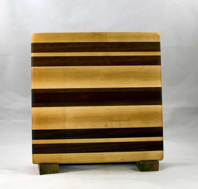 "Small Board 16 - 022. Bubinga, Black Walnut & Hard Maple. 10"" x 10"" x 7/8""."