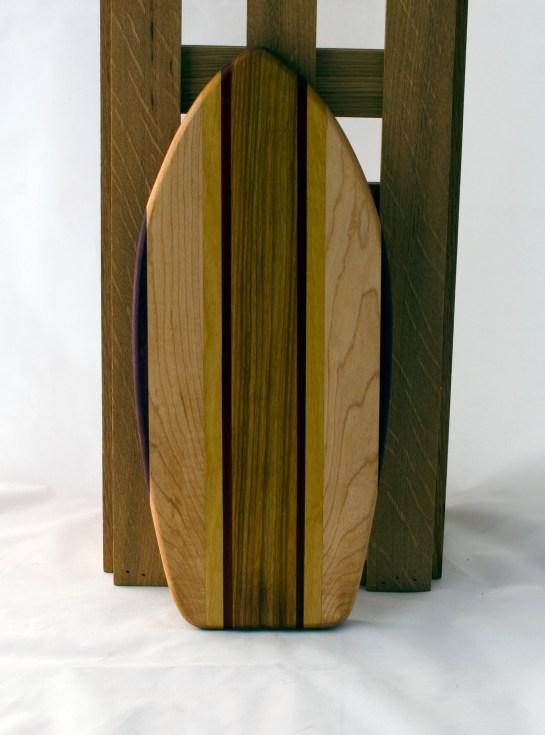 "Small Surfboard 16 - 13. Purpleheart, Hard Maple, Yellowheart & Canarywood. 6"" x 16"" x 3/4""."