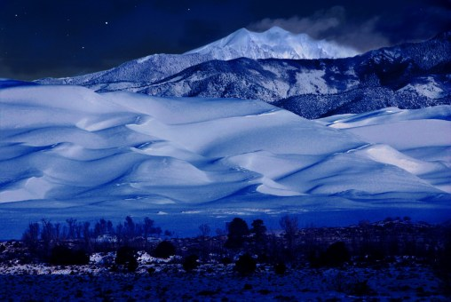 Moonlight brightens snowy dunes at Great Sand Dunes National Park and Preserve in Colorado. Photo by Patrick Myers, National Park Service. Posted on Tumblr by the US Department of the Interior, 1/2/17.
