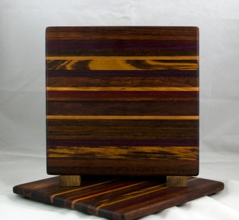 "Cheese Board 17 - 318. Jatoba, Purpleheart, Cherry, Goncalo Alves & Bloodwood. Chaos Board. 11-1/4"" x 11-1/2"" x 1/2""."