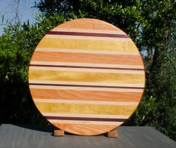 "Lazy Susan 17 - 05. Honey Locust, Hard Maple, Purpleheart & Yellowheart. 18"" diameter."
