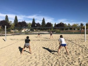 Moxie Beach players practicing beach volleyball