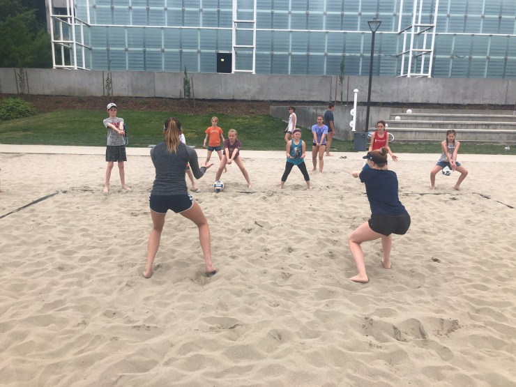 Third through sixth grade players learning beach volleyball