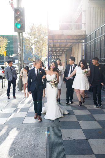 Downtown city wedding. Bridal party walking through streets. Moxie Bright Events.