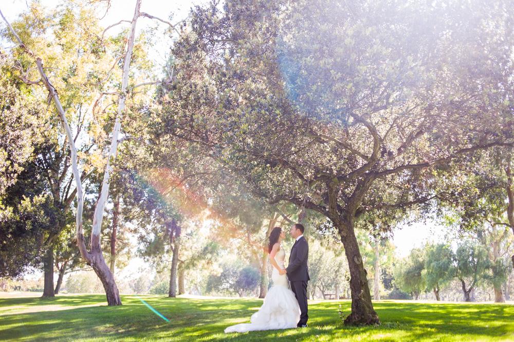Bride & Groom wedding day portrait with rainbow