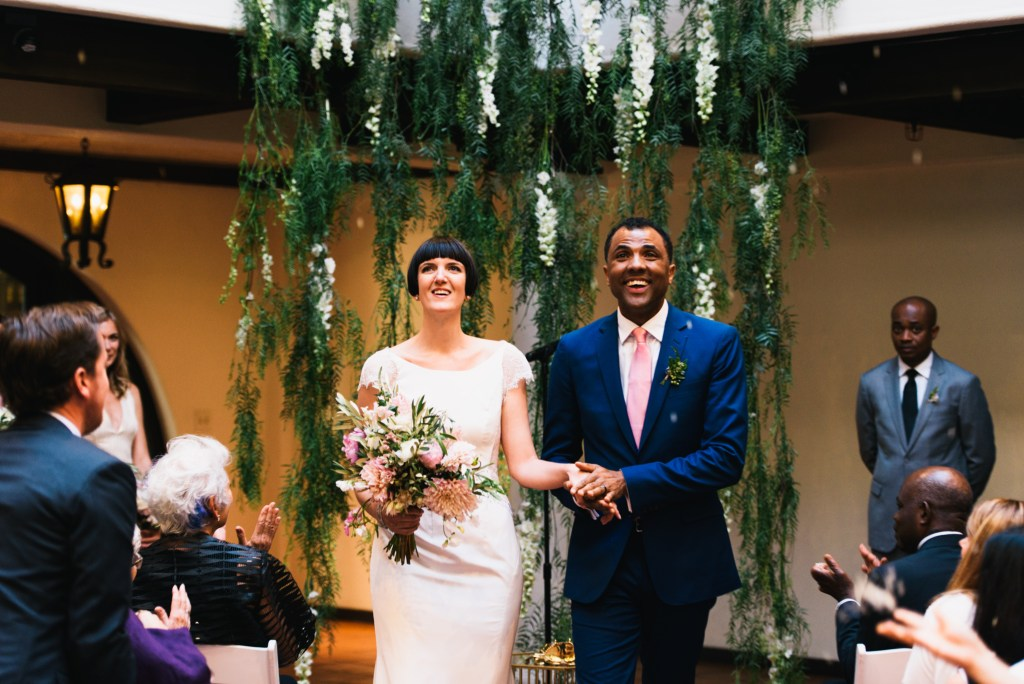bride & groom, greenery floral backdrop