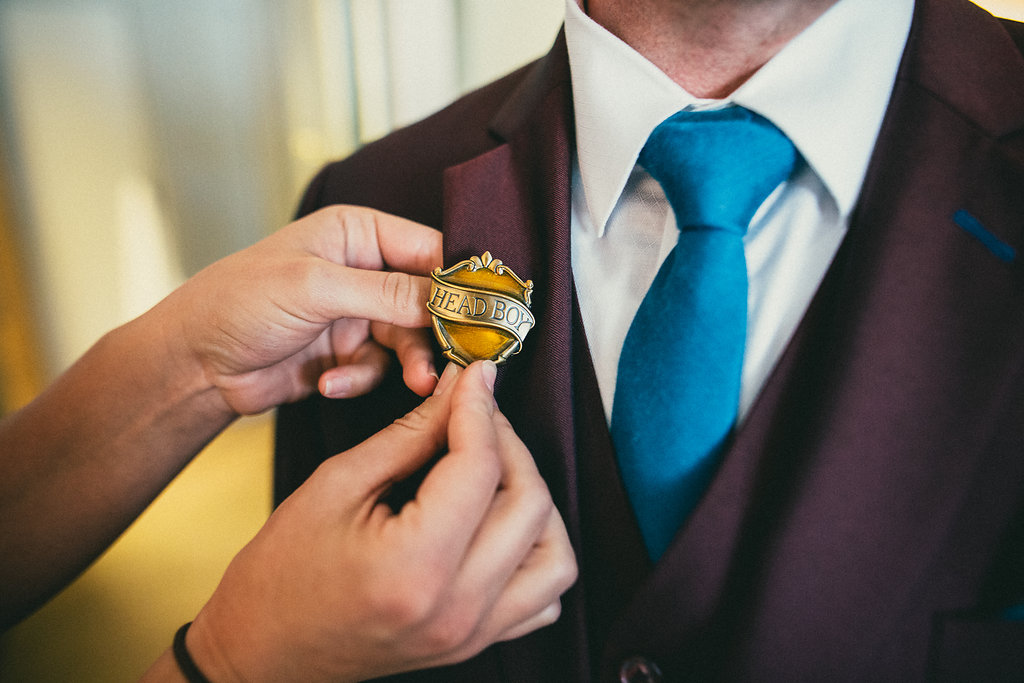 groom with Head Boy pin, Harry Potter wedding details, Best Wedding Planner Los Angeles Moxie Bright Events