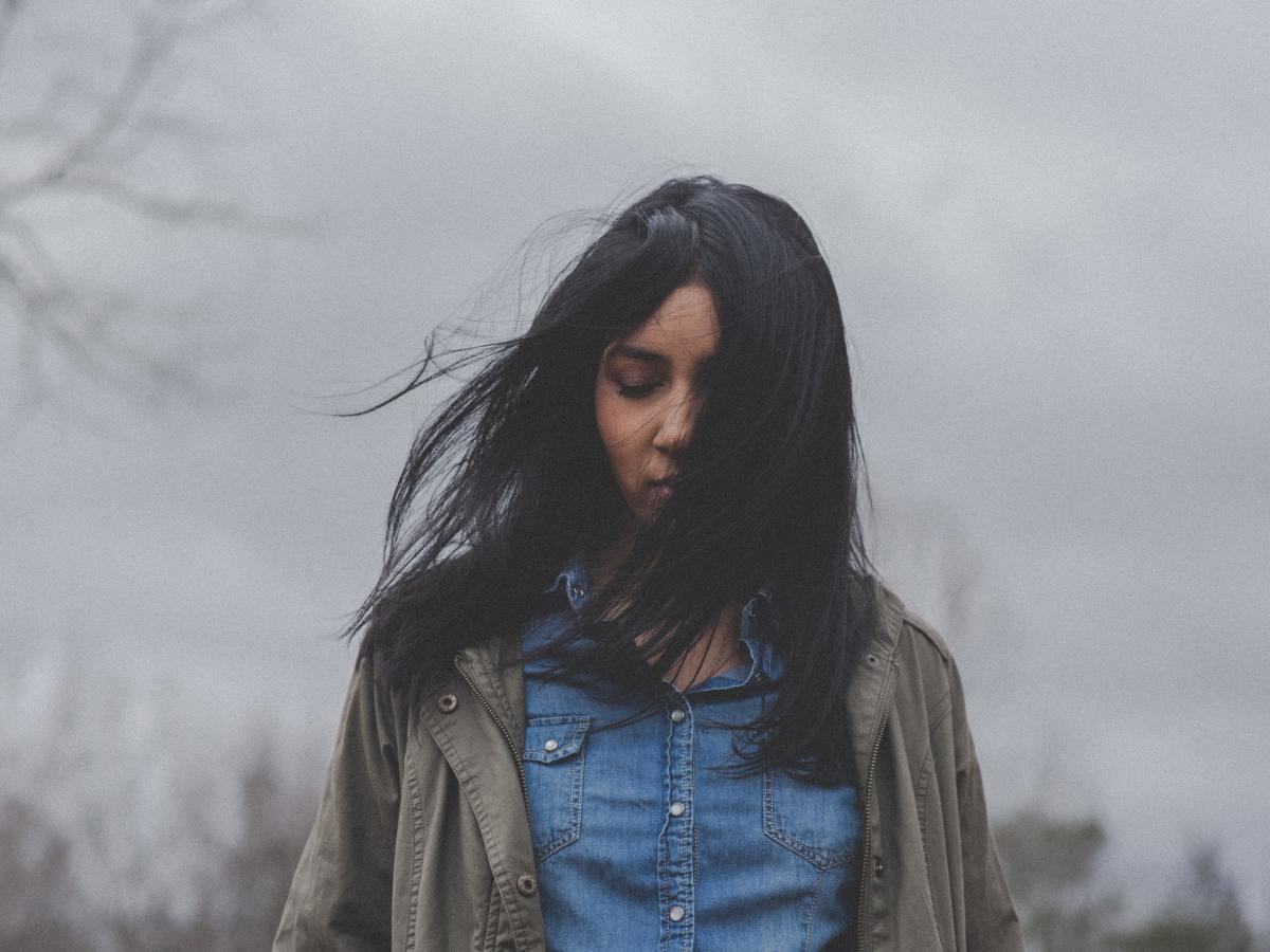 Woman standing outside on a gray day. She is struggling with anxiety and depression, and has been seeking the right treatment. Moxie Family Therapy offers emdr treatment in california. Contact us today for emdr therapy for ptsd, and more.