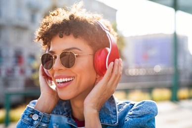 Smiling woman with sunglasses listens to music with her headphones. She is happy because she has received emdr therapy in california. Moxie Family Therapy offers emdr therapy in orange county. Contact our emdr trained therapist for emdr treatment for ptsd, emdr trauma therapy, and other services. Contact us today.