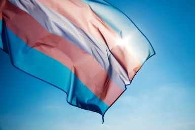 Image of a trans flag blowing in the wind on a sunny day. LGBTQ therapy in Orange County, CA can help you overcome issues facing the LGBTQIA+ community. Learn more about LGBT therapy in Santa Ana, CA from a LGBTQ therapist today!
