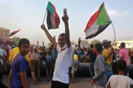 KHARTOUM, Sudan - Sudanese men protest against a military coup that overthrew the transition to civilian rule, on October 25, 2021 in the al-Shajara district in southern Khartoum