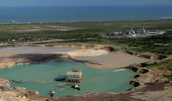 Aerial view of the mine pond, processing plant and the jetty. Image courtesy of Kenmare Resources plc.