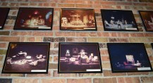 Images of former theatre performances are displayed in the hallway of Bush Theater.