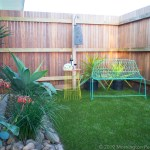 Private yard of the Beach Club Cottage, 3 by 9m fully fenced with an artificial lawn.