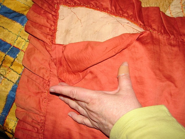 The back of the quilt is ripping and should be repaired.