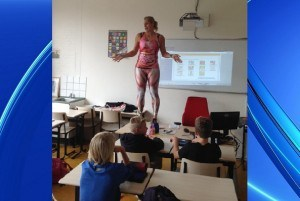 Teacher Stands On Her Desk, Removes Clothes To Give Students Better During Class