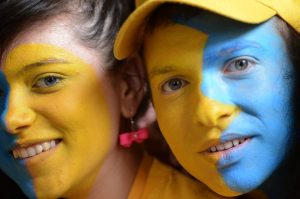 Ukrainian football fans pose with their
