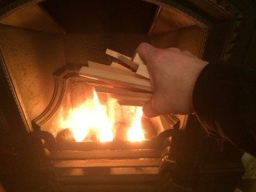 Adding kindling to a fire