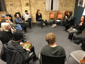 Eight focus group participants seated on chairs in a circle