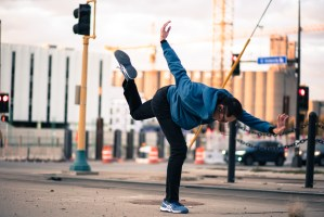 Photo of a person dancing alone in an urban landscape