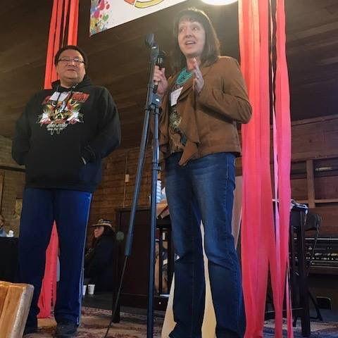 Anishinaabe Arts Initiative Council member Deb Warren (White Earth Band) awards master bead worker Thomas Stillday (Red Lake Nation) with an AAI Fellowship.