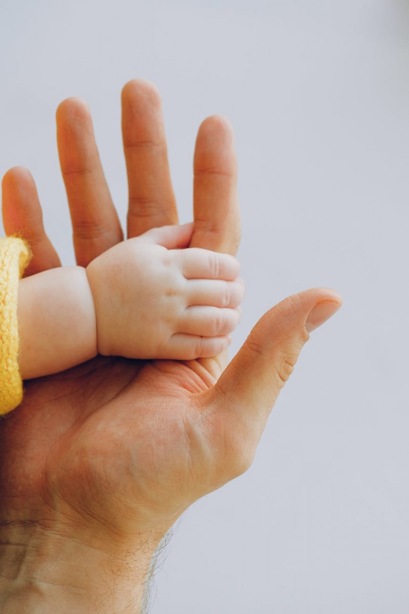 person holding babys hand