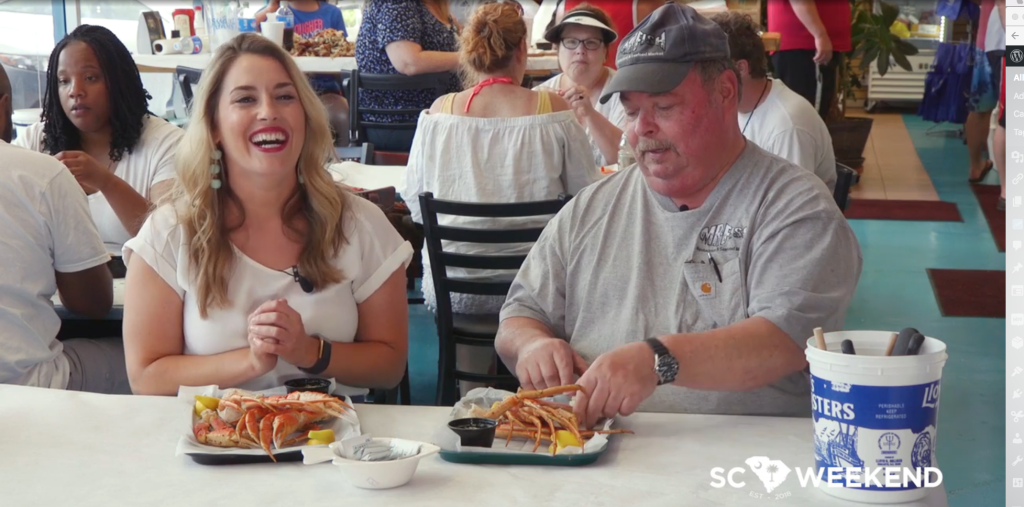 Halley Murrow and Mr Fish laughing during crab legs eating demonstration