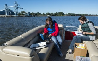 SVSU students conducting water research aboard the Cardinal II. Courtesy SVSU.