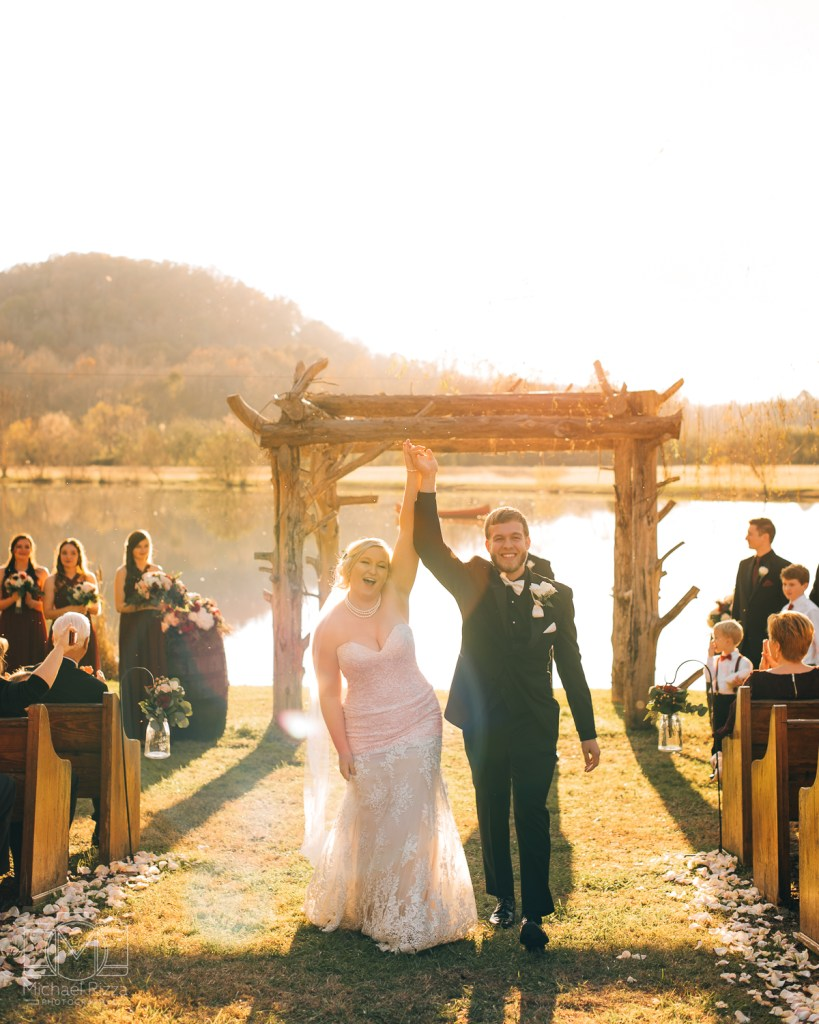 Erin and Sam during their sunset wedding