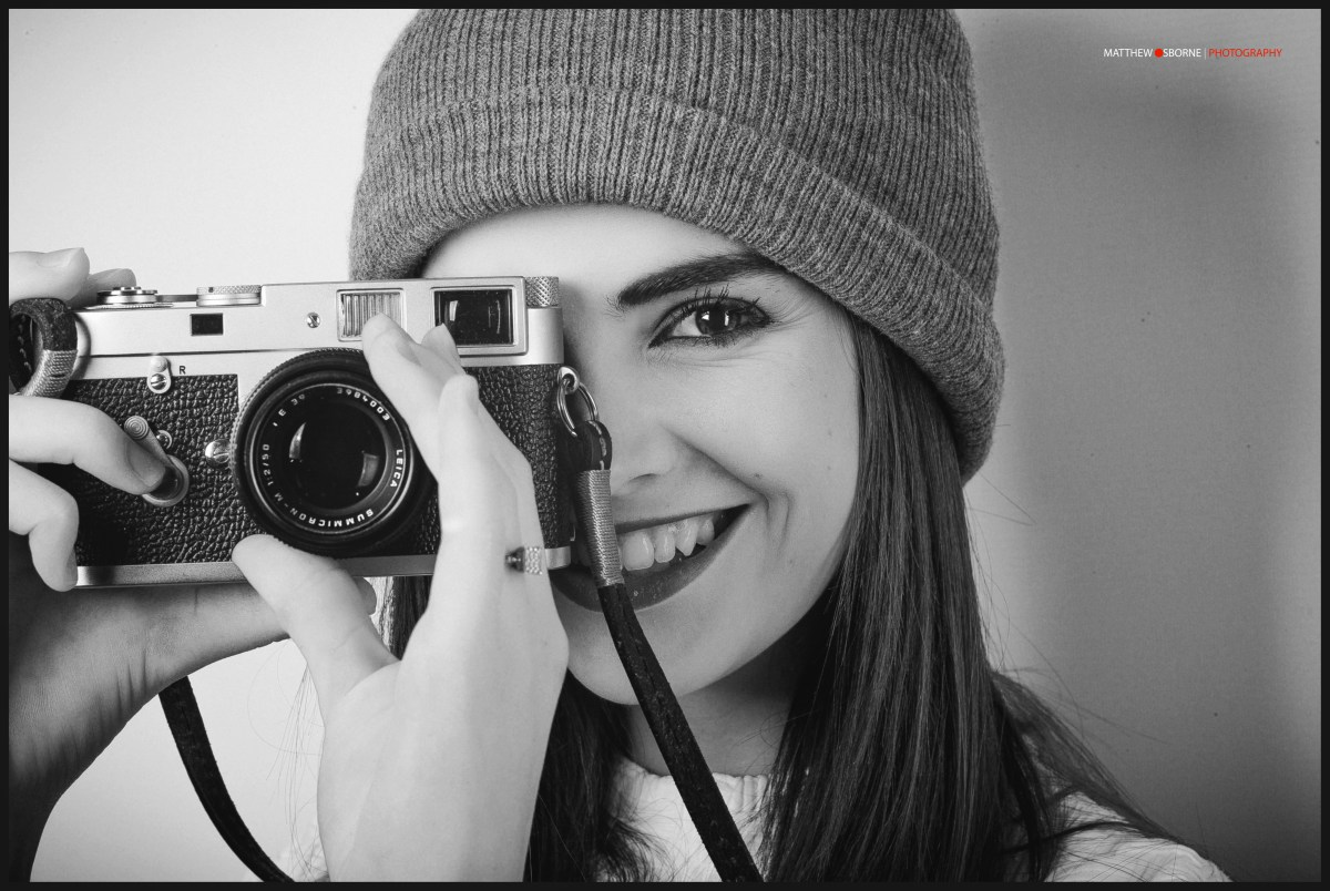 happy girl with leica camera smile