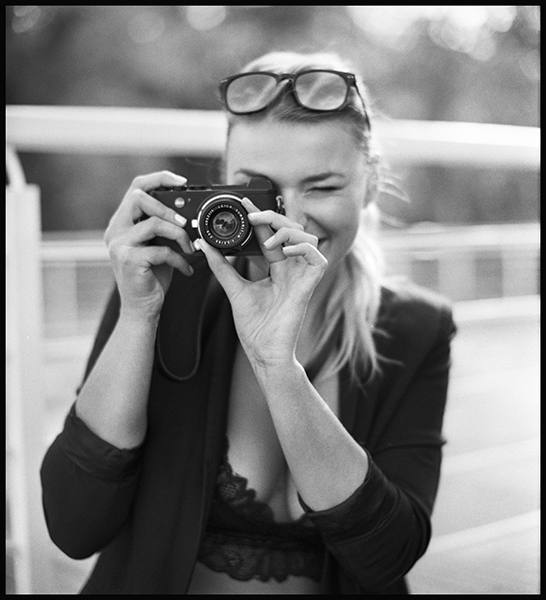 Leica CL vs Leica M8 review - girl photographer with leica Cl B&W