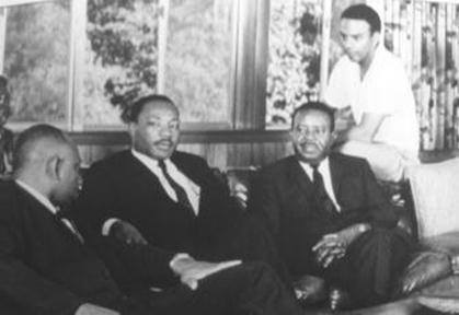 Herman J. Russell, Dr. Martin Luther King Jr., Dr. Ralph Abernathy, Andrew Young, photographed in Russell's living room, Mr. Media Interviews