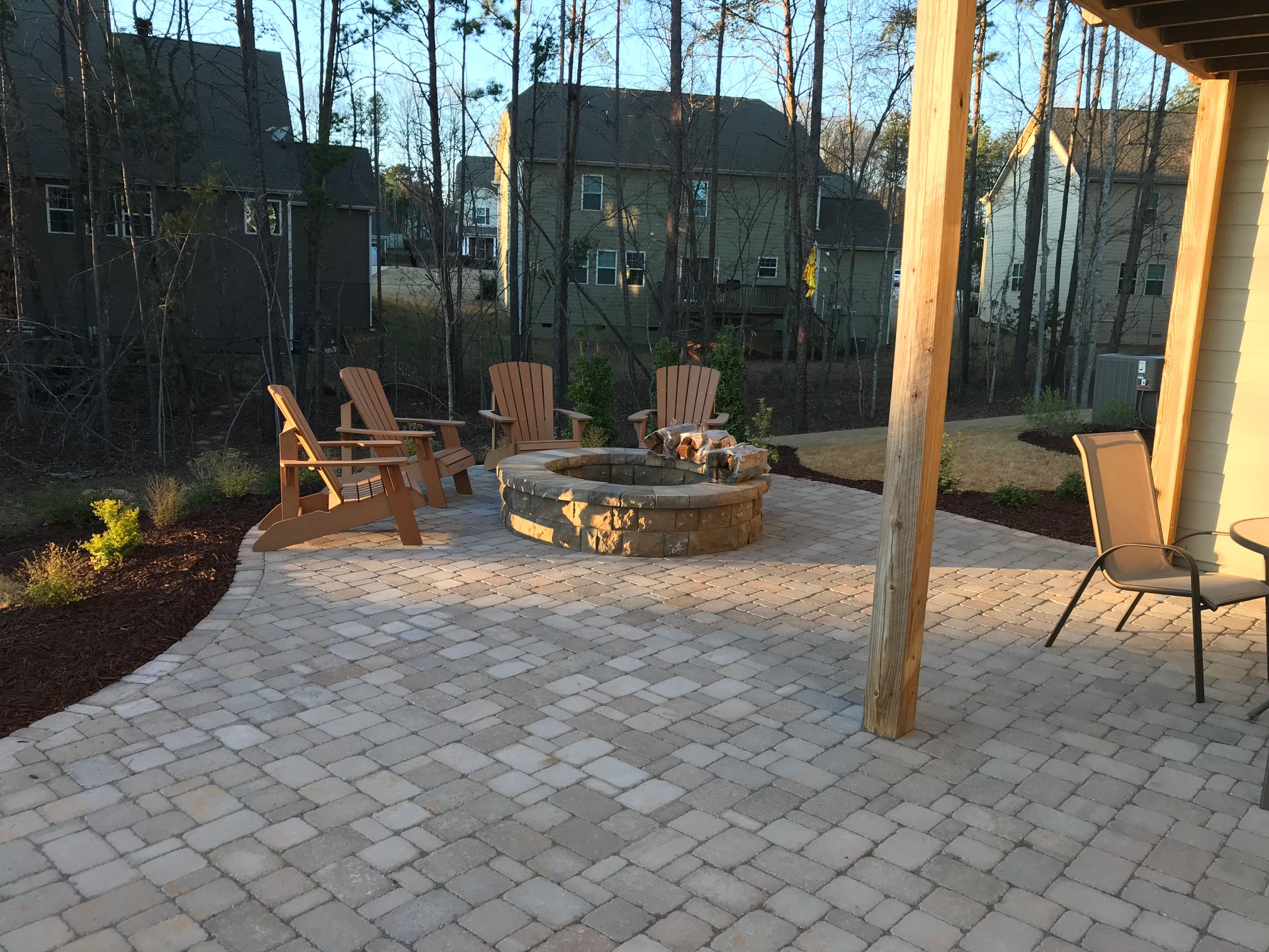 A Belgard Paver Patio, Fire Pit And Landscaping