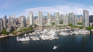 """Photo 1: 42 1088 MARINASIDE Crescent in Vancouver: Yaletown Condo for sale in """"QUAYSIDE MARINA"""" (Vancouver West)  : MLS®# R2376189"""