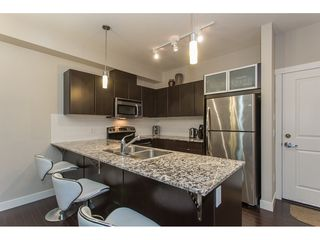 """Photo 4: 211 9655 KING GEORGE Boulevard in Surrey: Whalley Condo for sale in """"GRUV"""" (North Surrey)  : MLS®# R2139260"""