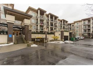 """Photo 1: 211 9655 KING GEORGE Boulevard in Surrey: Whalley Condo for sale in """"GRUV"""" (North Surrey)  : MLS®# R2139260"""