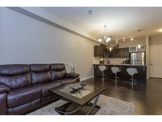 """Photo 9: 211 9655 KING GEORGE Boulevard in Surrey: Whalley Condo for sale in """"GRUV"""" (North Surrey)  : MLS®# R2139260"""