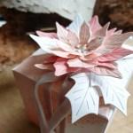 Poinsettia giftwrap decor