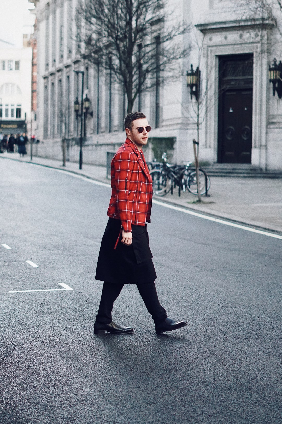 London Fashion Week. Wearing Sixth June Tartan Biker Jacket, ASOS Skinny Trousers With Wrap Button Up Skirt In Black and Zara Shoes.
