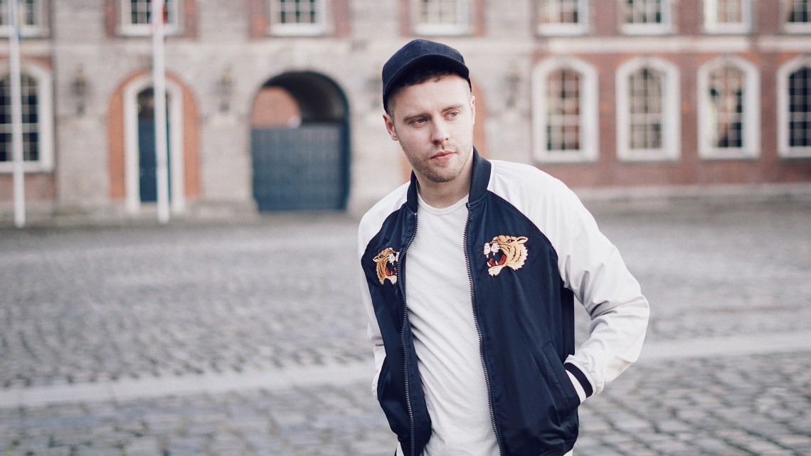 Tigers in Japan. Wearing Baseball Jacket from H&M, Off White Distressed Longline T-Shirt from Topman and Backpack from RAINS. Shot outside The Dublin Castle in Ireland.