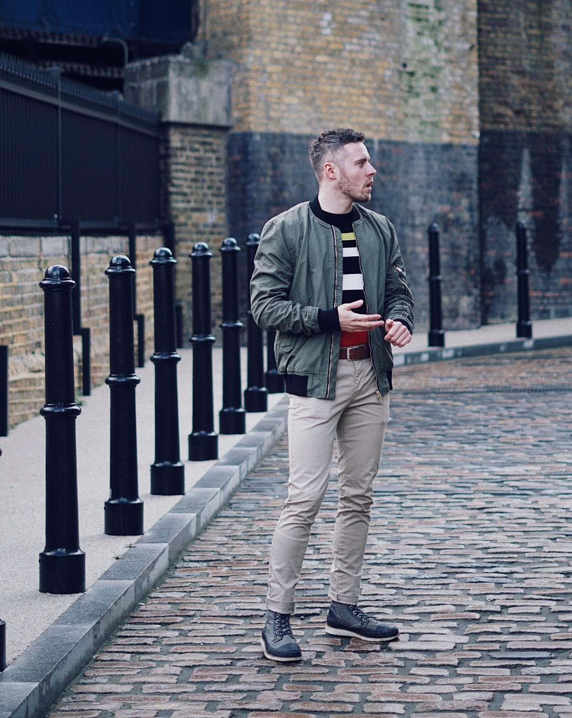 Tucked in Militaire. Wearing Padded Bomber Jacket from H&M, Colour Block Ripple Textured Jumper from Topman and Stone Stretch Skinny Chinos from Topman. Snapped in Southwark, London.