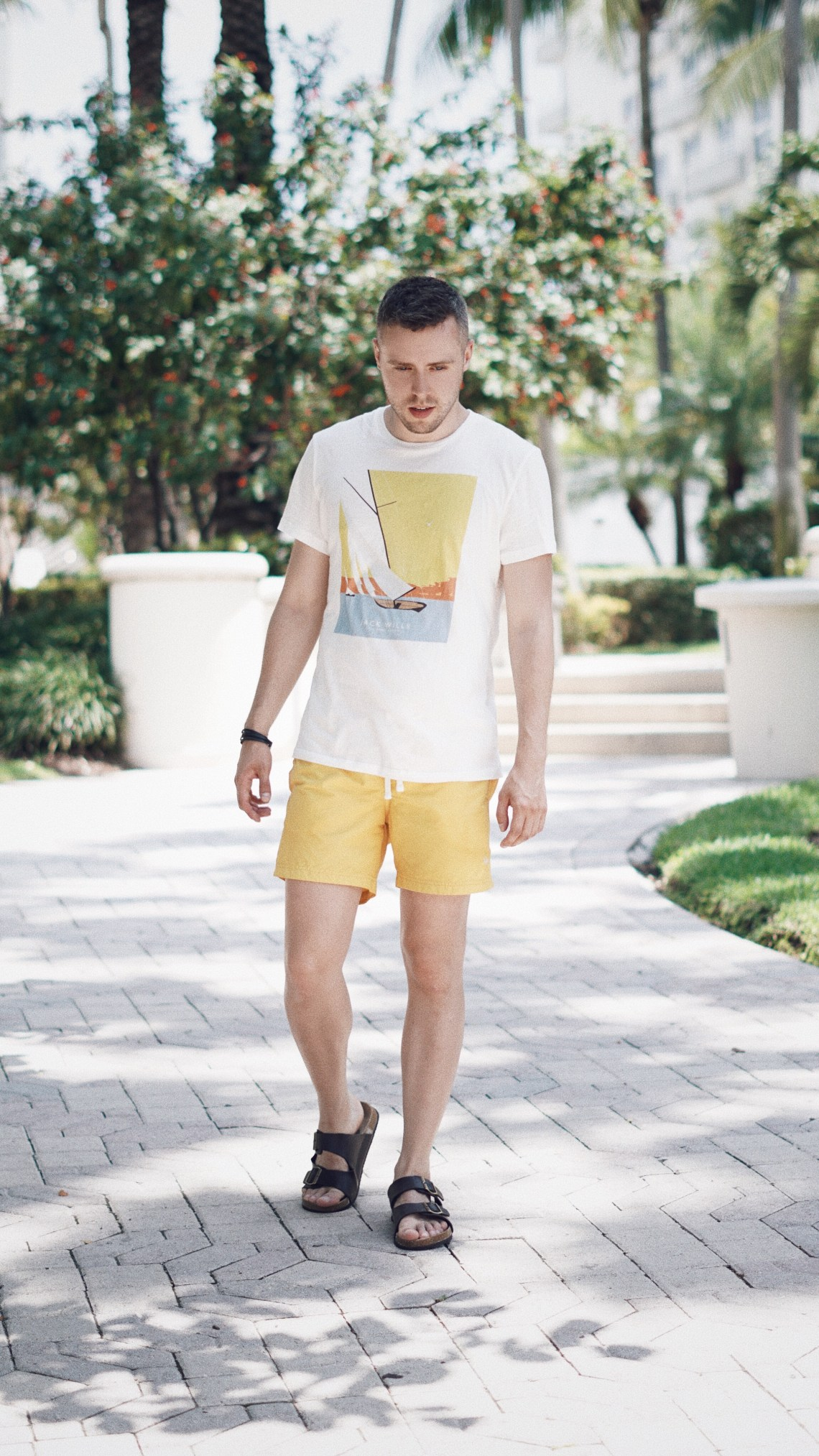 Yellow Mellow. Wearing Branwell Swim Trunks and Wentworth Summer T-shirt from Jack Wills, Classic Kånken Backpack from Fjällräven and Black Buckle Slip Ons from Primark. Shot outside Loews Hotel in South Beach, Miami. Blog by Skirmantas Petraitis