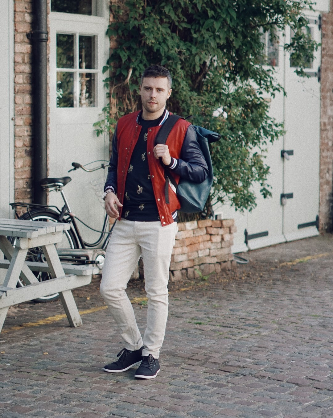 St Lukes Mews in Notting Hill. Wearing KRONABY Sweden Sekel Watch, Zara College Bomber Jacket and Printed Top in Navy Blue, Primark Stone Twill Stretch Skinny Trouser and Boxfresh Shoes. Snapped by Ed Lemon from The Discerning Man. Blog by Skirmantas Petraitis
