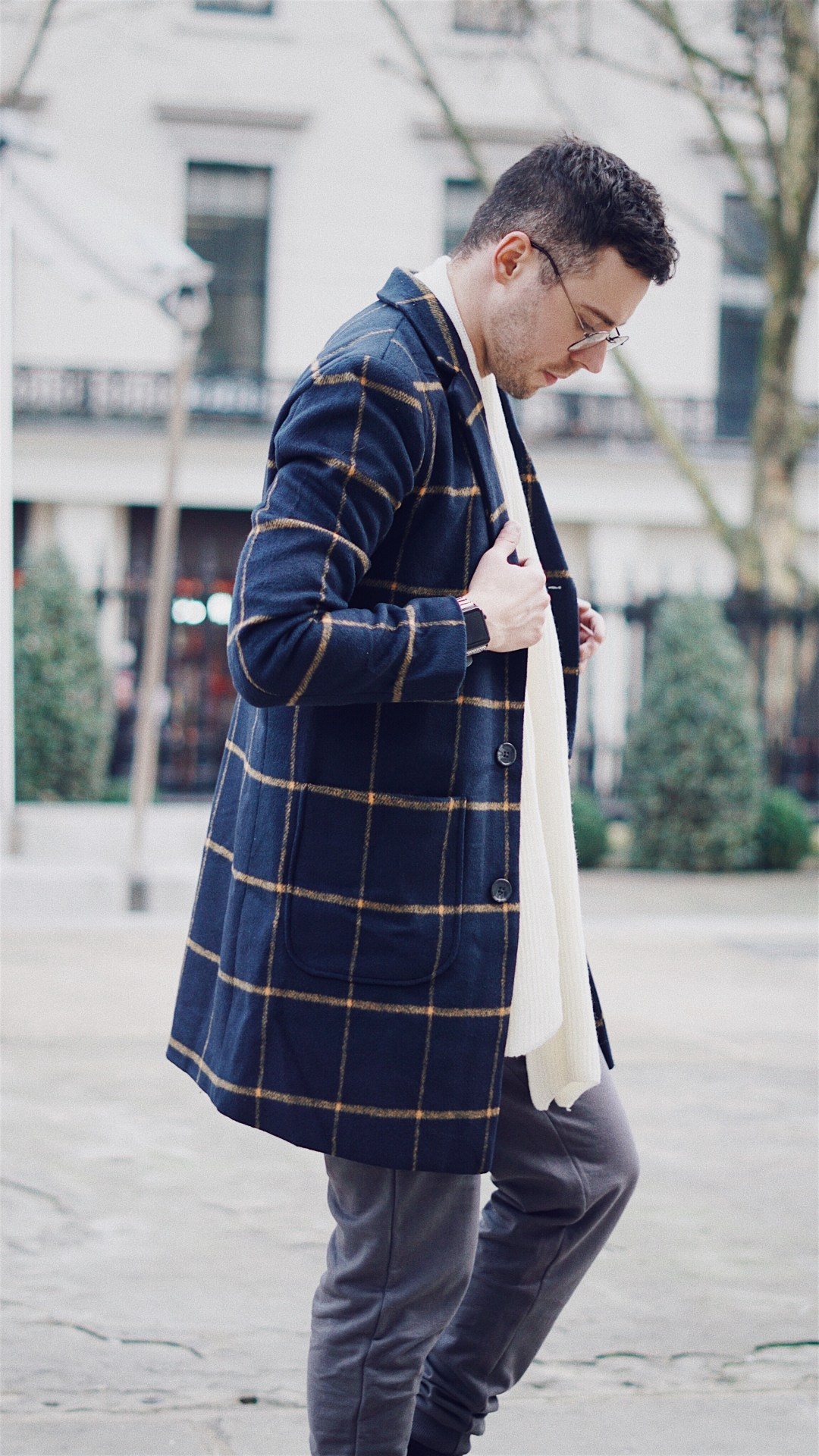 The Idle Man. Wearing Check Overcoat in Navy,Classic Long Sleeve T-Shirt in Grey,Slim Fit Joggers in Grey andKnitted Scarf Off White. Also, Goodwin Smith Bashall Boots in Black and Apple Watch Strap in Monochrome from Case Station. Shot by Oliver Burton @ByOllieB. Blog by Skirmantas Petraitis.
